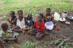Children-playing-games-while-mamies-are-weeding.-Togo